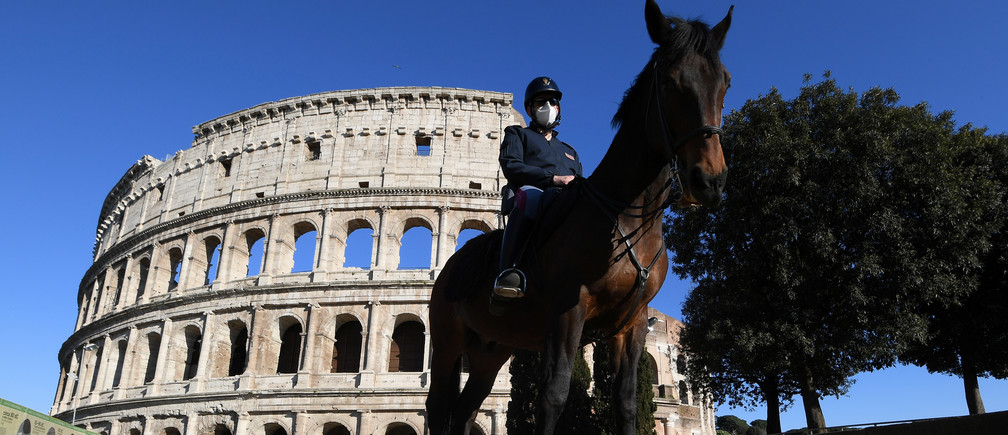 An Italian mounted police officer is seen in front of the Colosseum, as the spread of the coronavirus disease (COVID-19) continues, in Rome, Italy, April 26, 2020.