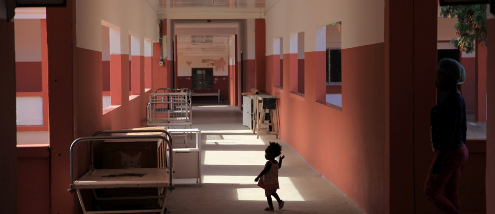 A toddler runs through Chiulo hospital in Cunene province, Angola.