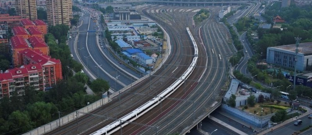 A Fuxing bullet train departs from Beijing South Railway Station to Shanghai, as the country restores the world's fastest bullet train, running at 350 kilometres per hour, six years after it reduced the speed of its trains, in Beijing, China September 21, 2017. China Daily via REUTERS  ATTENTION EDITORS - THIS IMAGE WAS PROVIDED BY A THIRD PARTY. CHINA OUT. NO COMMERCIAL OR EDITORIAL SALES IN CHINA.     TPX IMAGES OF THE DAY - RC1B74395C60