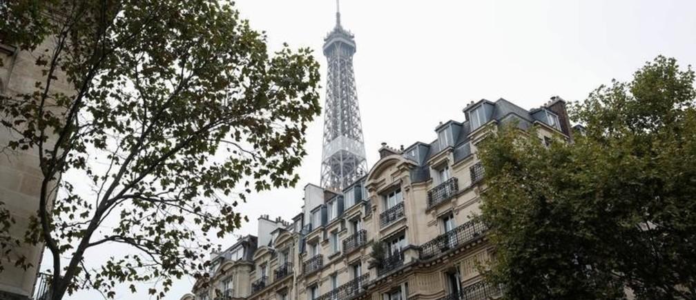 The Eiffel Tower stands near luxury Hausmannian buildings in the 7th arrondissement district of Paris, France, October 23, 2019. REUTERS/Benoit Tessier - RC1EF47A3320