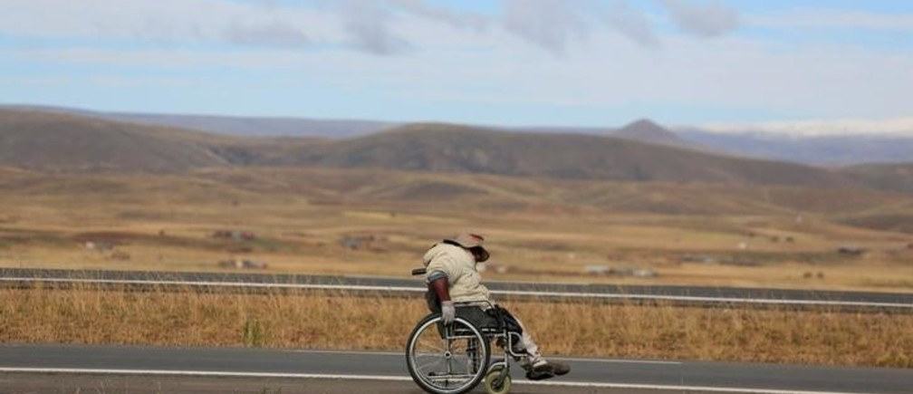 A man with physical disabilities participates in a protest march to demand that the government increase their monthly disability subsidy by 500 Bs, near Ayo Ayo, Bolivia April 20, 2016. REUTERS/David Mercado?