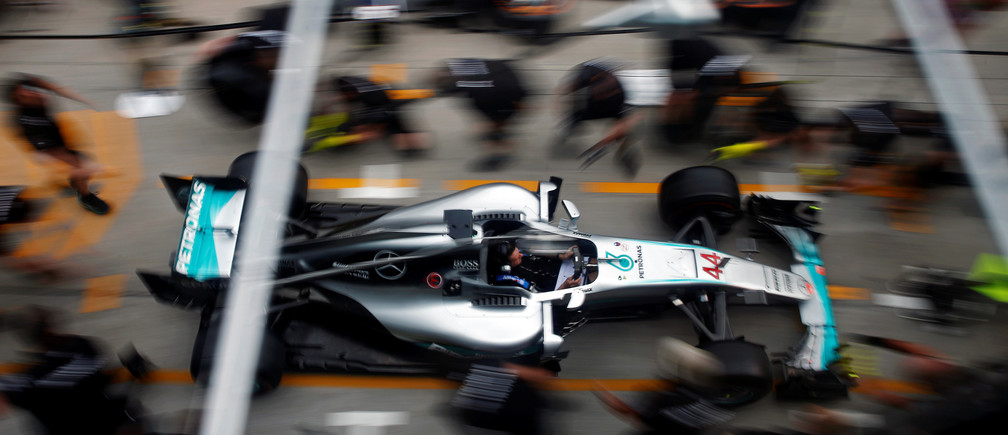 Formula One - F1 - Malaysia Grand Prix - Sepang, Malaysia- 29/9/16. Crew members push the car of Mercedes' Lewis Hamilton of Britain for a change of tyres.