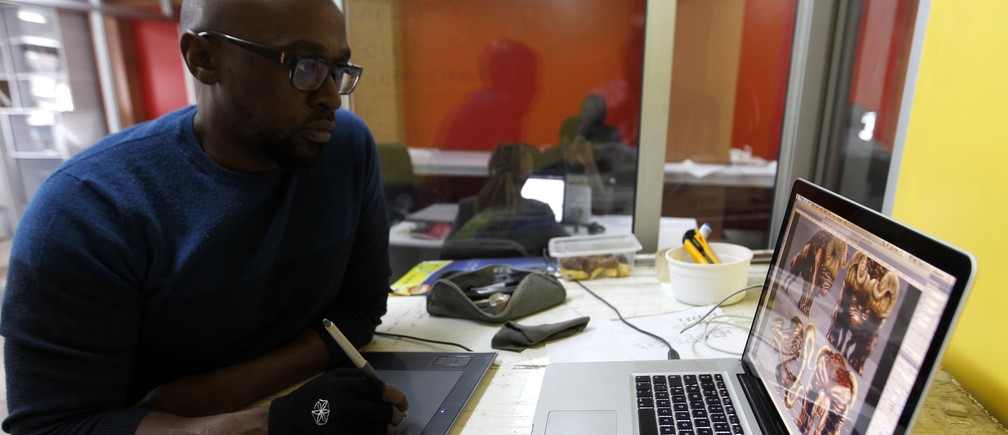 Mwaura Kirore, a creative director at Planet Rackus, works on MA3Racer, a 2D mobile game inside his studio in Kenya's capital Nairobi, July 15, 2014.