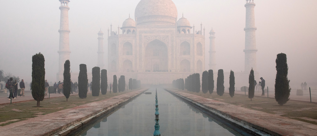 The Taj Mahal is seen through morning air pollution in Agra, India, January 12, 2019. Picture taken January 12, 2019. REUTERS/Andrew Kelly.