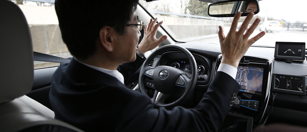 Nissan's head of automated driving, Tetsuya Lijima, sits at the controls of a modified Nissan Leaf, driverless car, during its first demonstration on public roads in Europe, in London, Britain February 27, 2017. REUTERS/Peter Nicholls - RTS10NKN