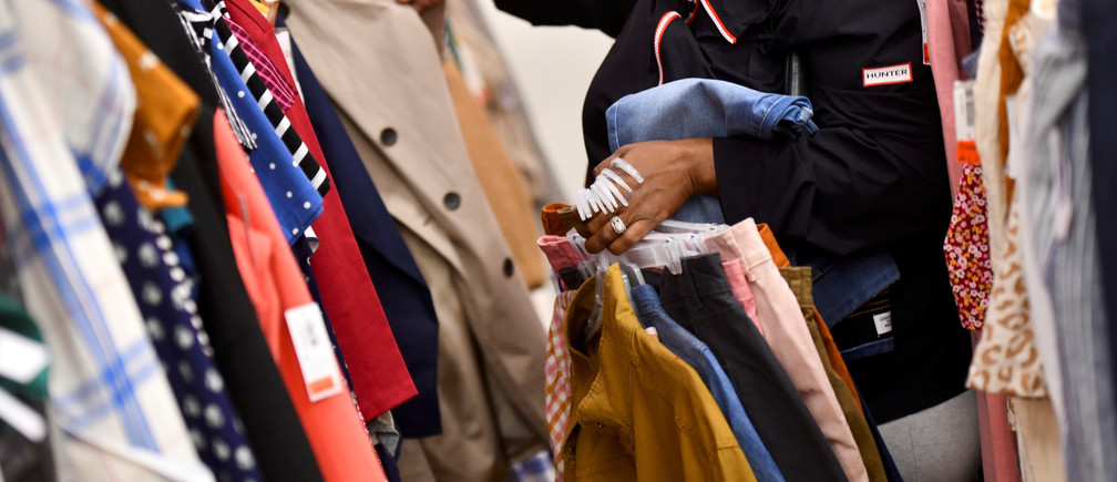 A shopper browses clothes at an Old Navy store as pre-Thanksgiving and Christmas holiday shopping accelerates at the King of Prussia Mall in King of Prussia, Pennsylvania, U.S. November 22, 2019. REUTERS/Mark Makela - RC2NGD9GVVR6
