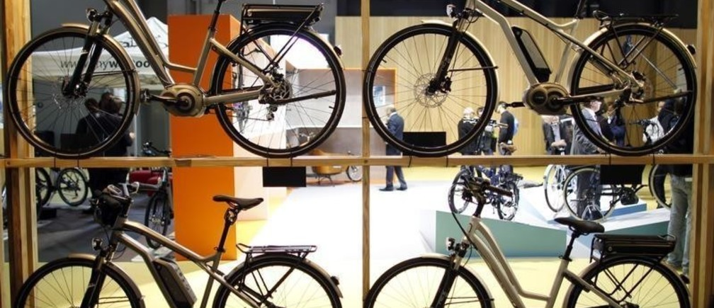 Electric bikes made by French company Moustache displayed during the Cycle Show 2013 in Paris September 13, 2013. The show, which runs from September 13 to September 16, presents 457 brands with racing bikes, urban and electric bicycles, equipment and accessories for cycling fans.   REUTERS/Charles Platiau  (FRANCE - Tags: SOCIETY SPORT CYCLING) - PM1E99D16V301