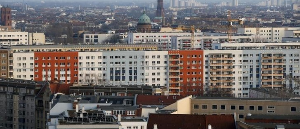Apartment buildings with the Saint Michael church (C) are pictured at Berlin's Kreuzberg district, Germany, March 1, 2016. REUTERS/Fabrizio Bensch/File Photo
