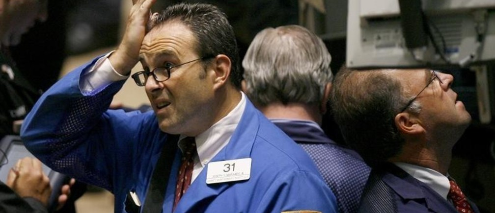 Traders work on the floor of the New York Stock Exchange August 9, 2007. U.S. stocks tumbled on Thursday, with the Dow and S&P down nearly 3 percent, after a French bank froze three funds that invested in U.S. subprime mortgages, prompting central banks to take steps to calm investors.