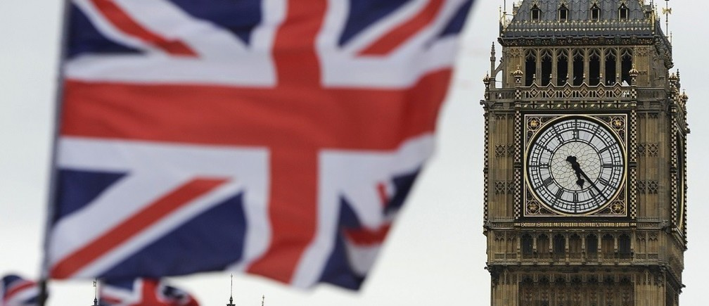 Flags are seen above a souvenir kiosk near Big Ben clock at the Houses of Parliament in central London.
