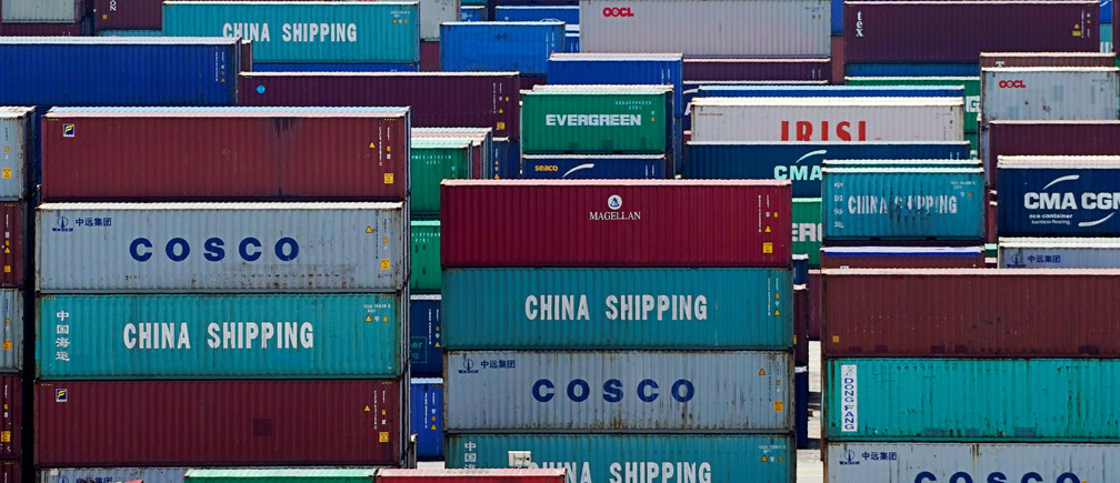 Containers are seen at the Yangshan Deep Water Port in Shanghai, China August 6, 2019.