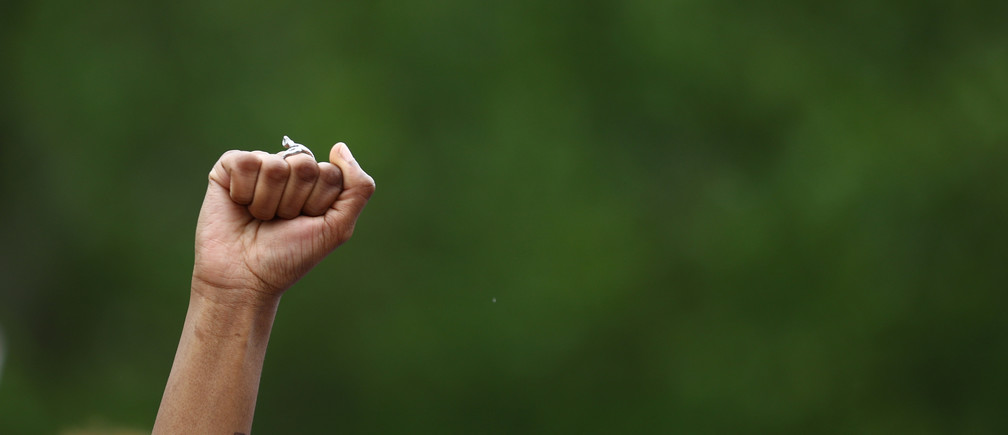"A persons fist is seen aloft in Hyde Park during a ""Black Lives Matter"" protest following the death of George Floyd who died in police custody in Minneapolis, London, Britain, June 3, 2020. REUTERS/Hannah McKay - RC2P1H901HH8"