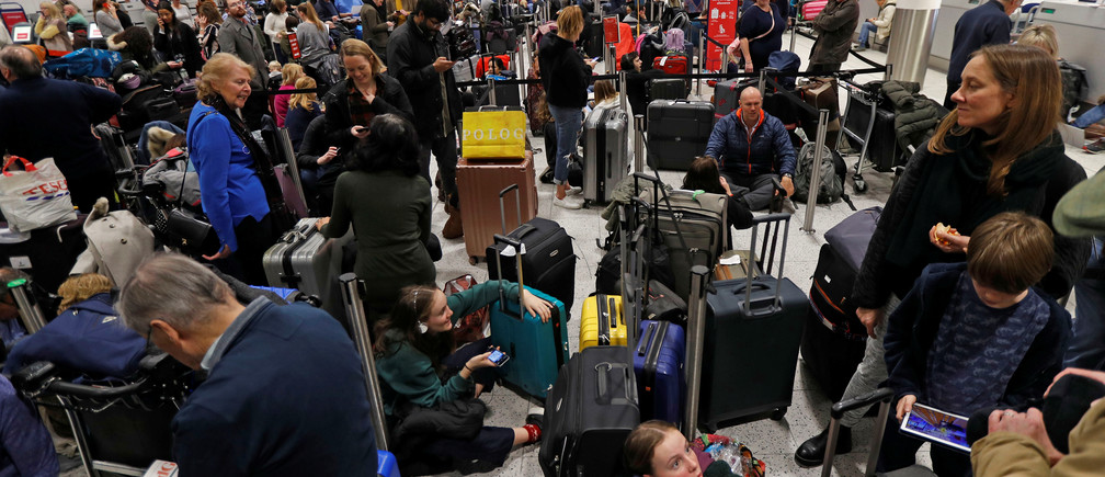 Passengers wait around in the South Terminal building at Gatwick Airport after drones flying illegally over the airfield forced the closure of the airport, in Gatwick, Britain, December 20, 2018. REUTERS/Peter Nicholls - RC1D6F1CB160
