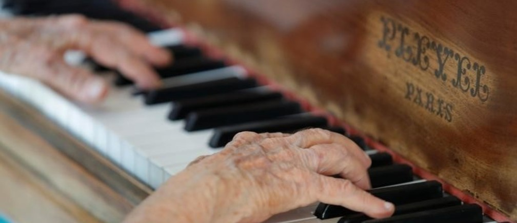The hands of Colette Maze, a 103-year-old Parisian pianist, are pictured as she plays piano at her home in Paris, France, April 20, 2018. Colette Maze, who started playing piano at the age of 4 and spent her whole life teaching piano, recently launched her fourth album paying a tribute to one of her favorite composer Claude Debussy. REUTERS/Philippe Wojazer - RC14F2AE0EB0