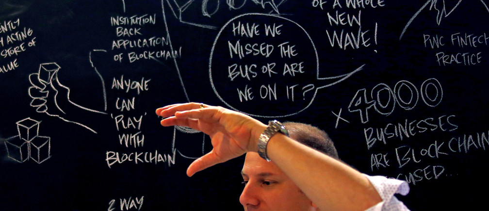 Alex Scandurra, CEO of Sydney fintech hub Stone & Chalk, talks in front of a drawing board located in the company's offices in central Sydney, Australia, April 26, 2016. REUTERS/David Gray - RTSERTZ