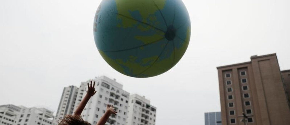 A child plays with a ball that represents an earth globe during the Global Climate Strike of the Fridays for Future movement in Sao Paulo, Brazil September 20, 2019. REUTERS/Nacho Doce ? - RC1DA8792760