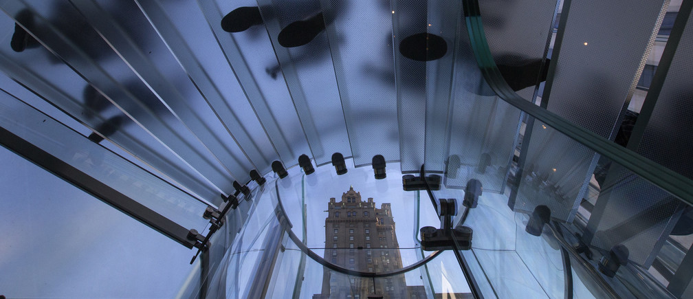 The Pierre building is seen through a stairway as customers enter the Apple retail store on Fifth Avenue in Manhattan,.