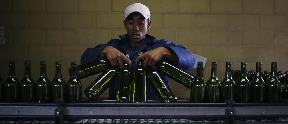 A worker loads wine bottles a Cape Town bottling plant.