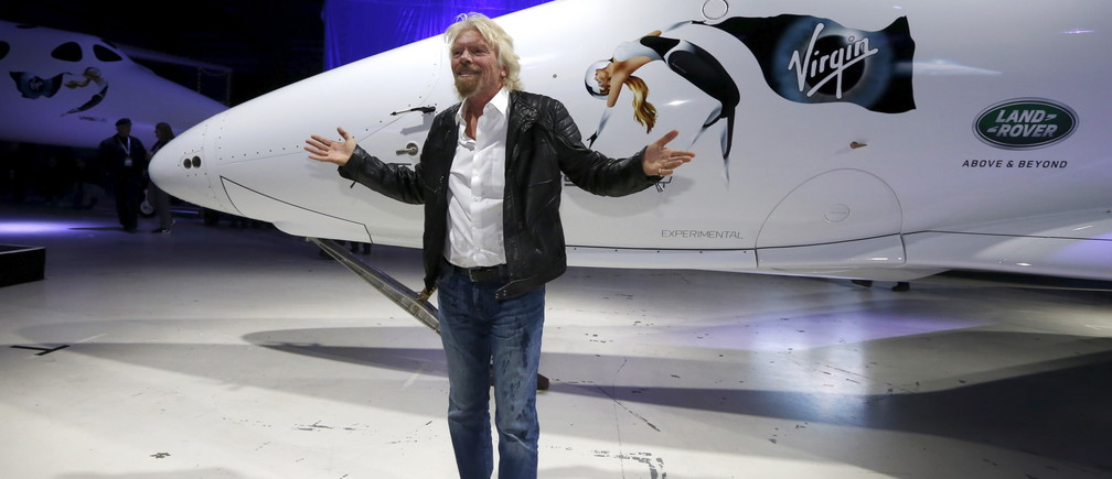 Richard Branson poses after unveiling the new SpaceShipTwo, a six-passenger two-pilot vehicle meant to ferry people into space that replaces a rocket destroyed during a test flight in October 2014, in Mojave, California, United States, February 19, 2016.  REUTERS/Lucy Nicholson - RTX27RNB
