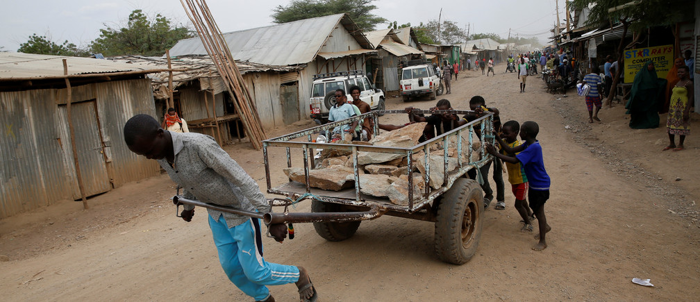 A man pulls a cart in the Kakuma refugee camp in northern Kenya, March 6, 2018. Picture taken March 6, 2018. REUTERS/Baz Ratner - RC180811C760