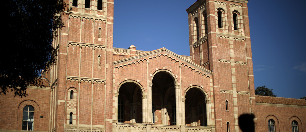 A student walks past Royce Hall on the University of California Los Angeles (UCLA) campus in Los Angeles, California, U.S. November 15, 2017. REUTERS/Lucy Nicholson - RC1C51CDA550