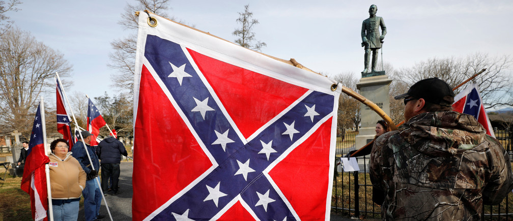 "Supporters of Confederate statues and symbols gather with their Confederate flags in front of the statue and resting place of General Thomas ""Stonewall"" Jackson on the Lee-Jackson Day state holiday in Lexington, Virginia, U.S. January 17, 2020. REUTERS/Jonathan Drake - RC2WHE9ZDY7D"