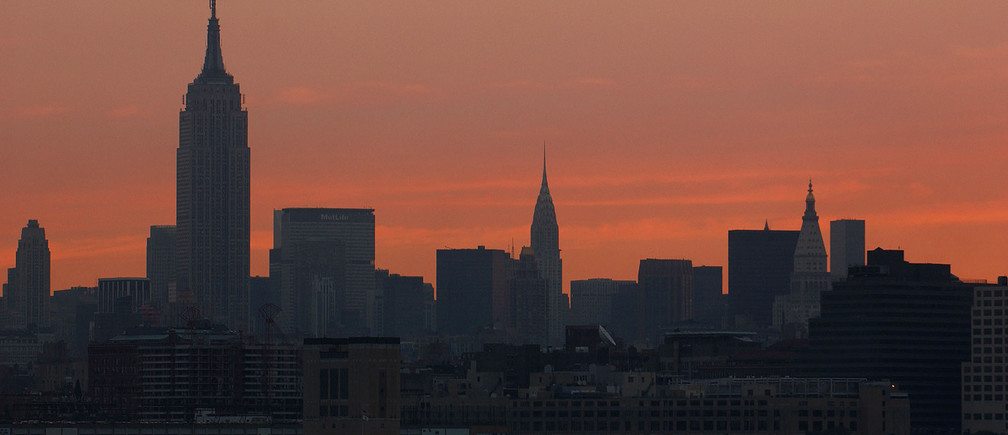 New York City skyline is seen at sunrise during a power outage August 15,2003. More than 12 hours after the biggest North American power outage inhistory left huge swaths of the Northeast in sweltering darkness, much ofNew York and its suburbs were still without electricity. The subways werenot running and many residents had no water because their electric pumpswere not working. REUTERS/Chip East   Pictures of the Year 2003 cmePOWER OUTAGES - RP4DRHYLJVAB