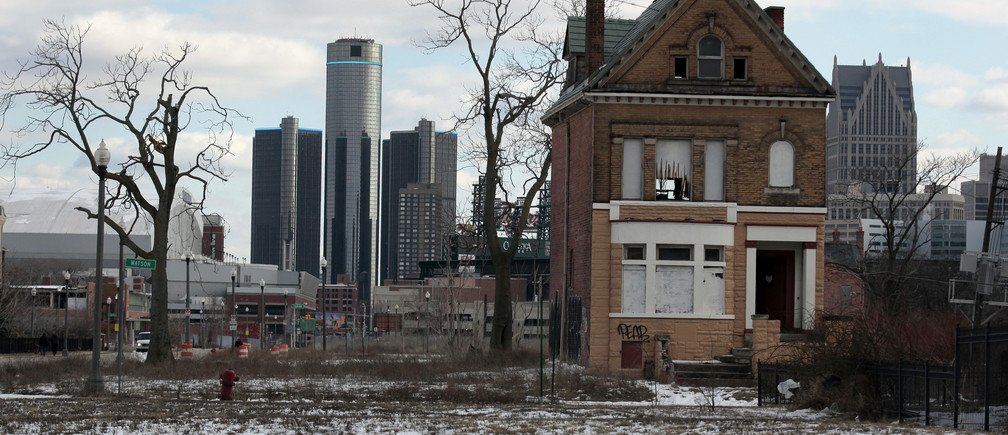 A vacant, boarded up house is seen in the once thriving Brush Park neighborhood with the downtown Detroit skyline behind it in Detroit, Michigan March 3, 2013. Michigan Governor Rick Snyder cleared the way for a state takeover of Detroit, declaring that the birthplace of the U.S. automotive industry faces a fiscal emergency and that he has identified a top candidate to assume its management. Friday's declaration by the Republican governor virtually assures that the state of Michigan will assume control of Detroit's books, and eventually decide whether the city should file the largest municipal bankruptcy in U.S. history.   REUTERS/ Rebecca Cook  (UNITED STATES - Tags: CITYSCAPE REAL ESTATE BUSINESS POLITICS) - GM1E9340K7A01