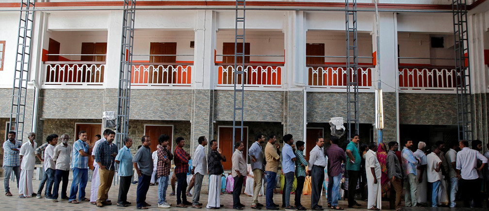 People wait in a queue to cast their votes at a polling station during the third phase of the general election in Kochi, India, April 23, 2019. REUTERS/Sivaram V - RC16E1FAD5C0