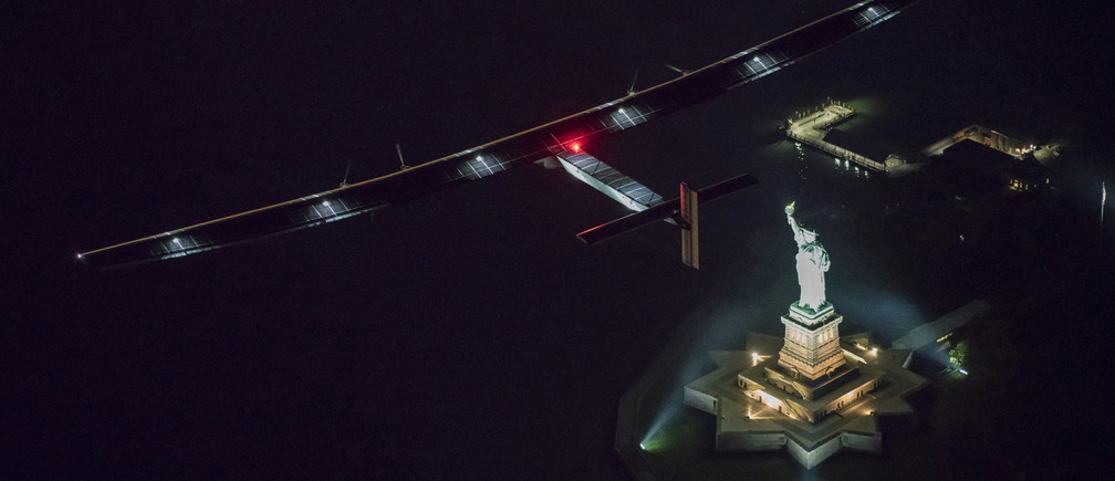 Solar Impulse 2, the solar airplane, piloted by Swiss adventurer Andre Borschberg, flies over the Statue of Libery in in New York, U.S., June 11, 2016 shortly before landing at John F. Kennedy airport. Leg 14 was the shortest so far on the planes trip around the globe.