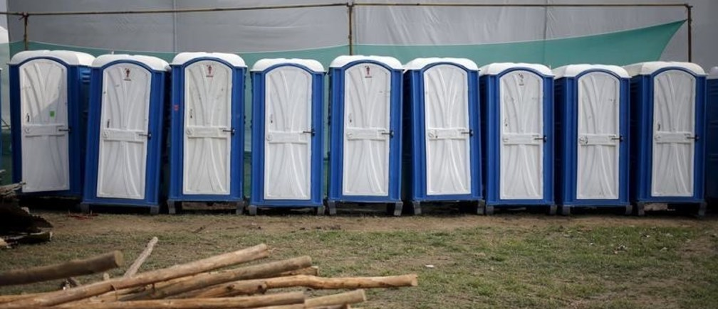 Temporary lavatories are seen at the venue of World Culture Festival on the banks of the river Yamuna in New Delhi, India, March 8, 2016. Indian environmentalists are aghast at the hosting of a huge cultural festival on the floodplain of Delhi's main river that begins on Friday, warning that the event and its 3.5 million visitors will devastate the area's biodiversity. Picture taken March 8, 2016. REUTERS/Anindito Mukherjee - GF10000339018