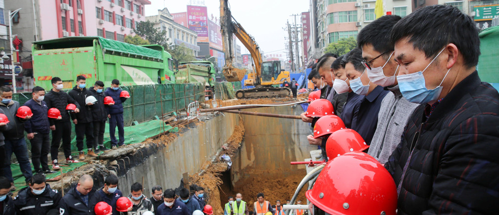 Workers observe a moment of silence at a construction site in Shaoyang, Hunan province, as China holds a national mourning for those who died of the coronavirus disease (COVID-19), on the Qingming tomb-sweeping festival, April 4, 2020. China Daily via REUTERS  ATTENTION EDITORS - THIS IMAGE WAS PROVIDED BY A THIRD PARTY. CHINA OUT. - RC2LXF9YCKZG