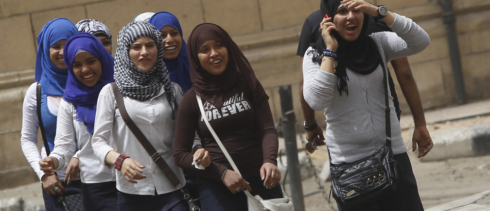 School girls walk on a street in Cairo, April 8, 2013. Egypt's National Council for Women (NCW) has proposed a new law against sexual harassment containing a minimum sentence of one-year imprisonment for first-time offenders, local media reported. Picture taken April 8, 2013.
