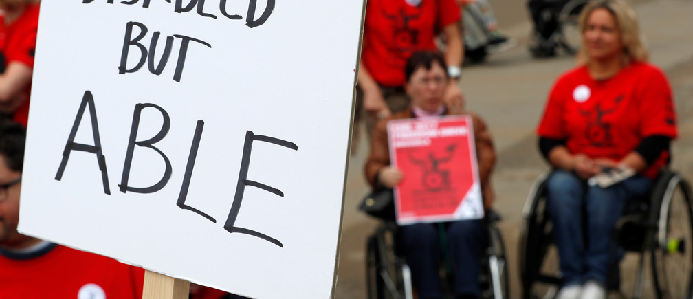 "Demonstrators with physical disabilities protest outside the European Commission headquarters, as part of the ""Freedom Drive"" campaign organised by the European Network on Independent Living to promote the rights of persons with disabilities, in Brussels, Belgium September 27, 2017.    REUTERS/Yves Herman - RC1B751DD840"