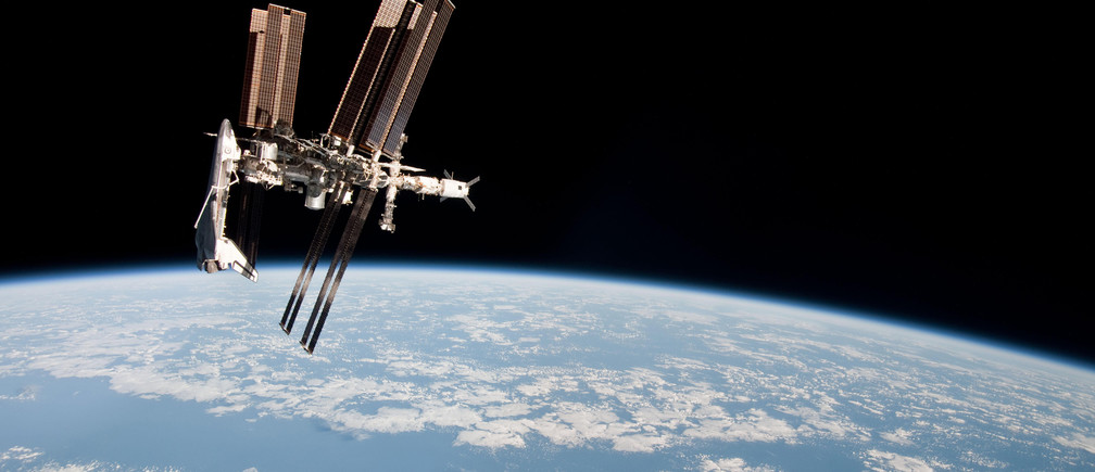The International Space Station is seen with the docked space shuttle Endeavour in this photo provided by NASA and taken May 23, 2011. The photo was taken by Expedition 27 crew member Paolo Nespoli from the Soyuz TMA-20 following its undocking.