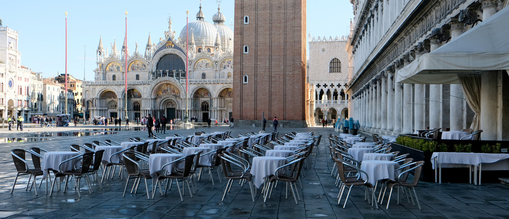 Empty restaurant tables are seen in St. Mark's Square as the Italian government prepares to adopt new measures to contain the spread of coronavirus in Venice, Italy, March 8, 2020.