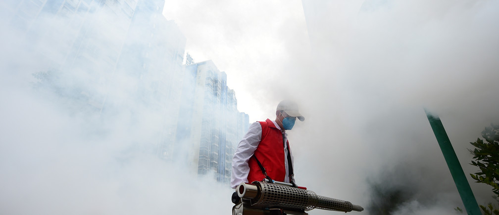 A volunteer disinfects a residential compound to prevent and control the novel coronavirus, in Ganzhou, Jiangxi province, China February 6, 2020. Picture taken February 6, 2020. China Daily via REUTERS  ATTENTION EDITORS - THIS IMAGE WAS PROVIDED BY A THIRD PARTY. CHINA OUT.