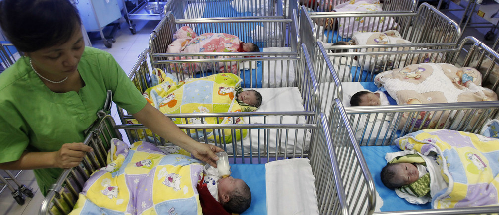 A nurse feeds a newborn baby at the Central Obstetrics Hospital in Hanoi October 27, 2011.