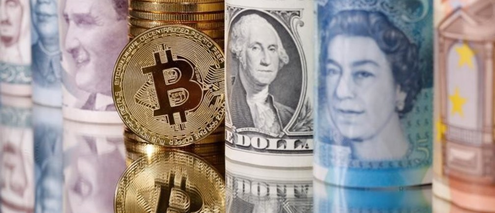 Representations of Bitcoin, Saudi riyal, yuan, Turkish lira, pound, U.S. dollar, ruro and Jordanian dinar banknotes are seen in this illustration taken January 6, 2020. REUTERS/Dado Ruvic/Illustration - RC26VE9LYLIS