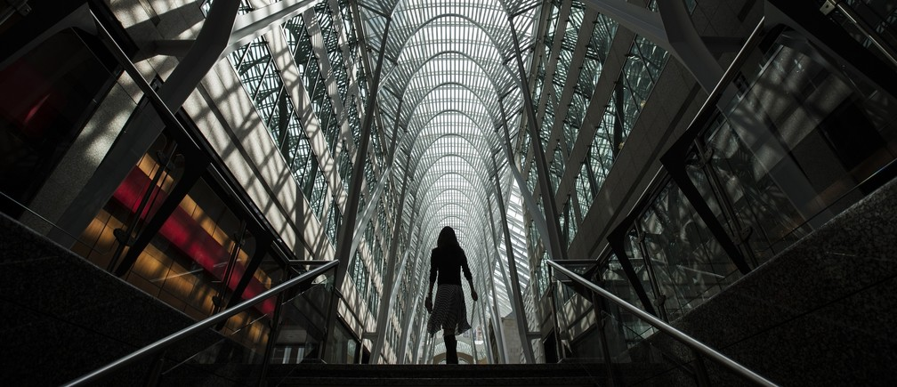 A woman walks through Brookfield Place off Bay Street, on the day of their annual general meeting for shareholders in Toronto, May 7, 2014.