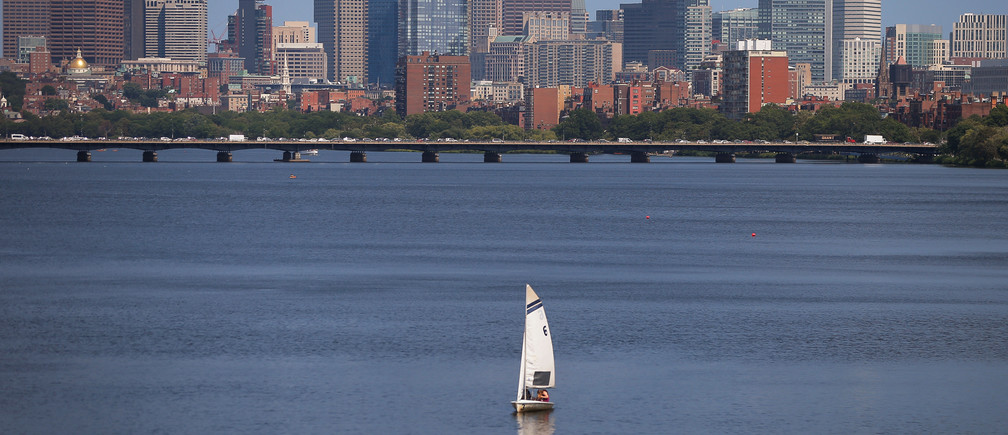 A sailboat makes its way along the Charles River in front of the skyline of Boston, Massachusetts, U.S., August 4, 2017.   REUTERS/Brian Snyder - RTS1AG1U