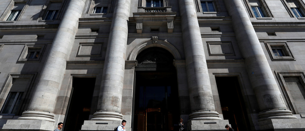 Pedestrians walk past the facade of Argentina's Banco Nacion (National Bank), in Buenos Aires, Argentina February 19, 2020. Picture taken February 19, 2020. REUTERS/Agustin Marcarian - RC214F9U4BPM