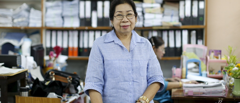 Sunisa Hongaroon, a 67-year-old accountant, poses for a portrait while working at a transportation company in Bangkok, Thailand.