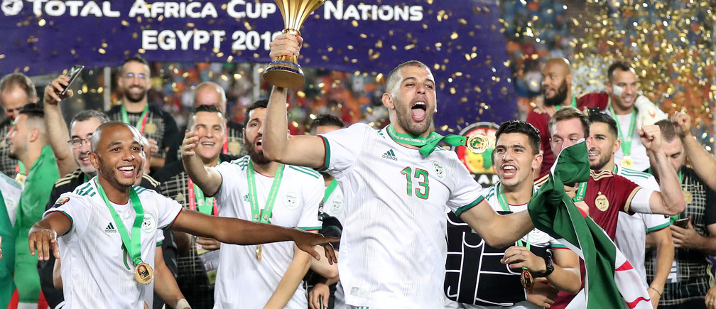 Soccer Football - Africa Cup of Nations 2019 - Final - Senegal v Algeria - Cairo International Stadium, Cairo, Egypt - July 19, 2019    Algeria's Islam Slimani celebrates with the trophy and team mates after winning the Africa Cup of Nations   REUTERS/Suhaib Salem - RC18789B7170