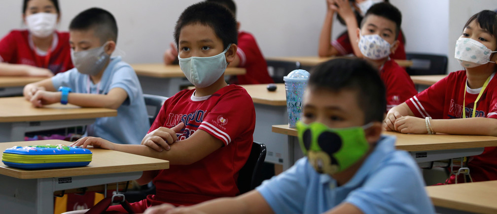 Primary school students wearing protective masks attend their first day of class after the government eased a nationwide lockdown during the coronavirus disease (COVID-19) outbreak in Ho Chi Minh, Vietnam May 11, 2020.