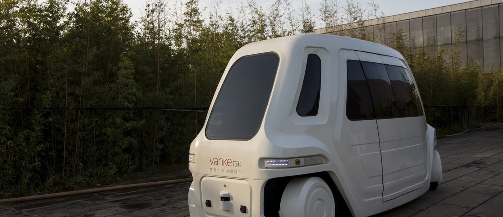 A driverless vehicle runs at Vanke's Building Research Centre testing area in Dongguan, south China's Guangdong province November 2, 2015.