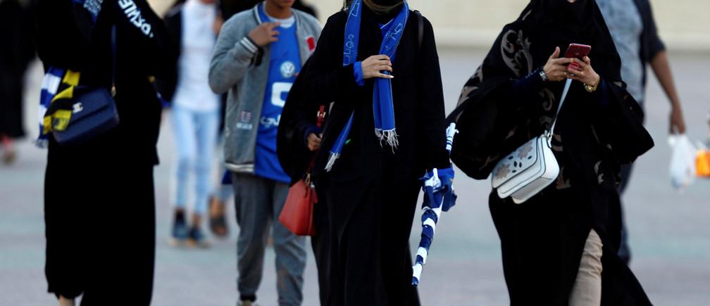 Saudi women arrive to watch the soccer match between Al- Hilal club against Al Ittihad club at the King Fahd stadium in Riyadh, Saudi Arabia January 13, 2018. REUTERS/Faisal Al Nasser - RC1193B69B30