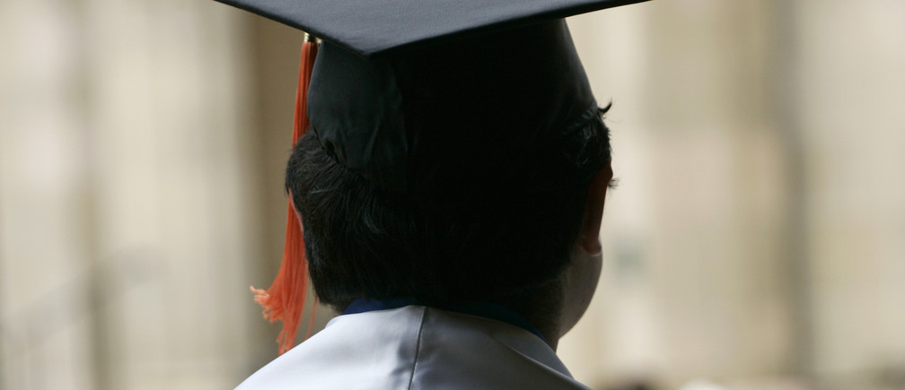 """An undocumented UCLA student attends a graduation ceremony for UCLA """"Dreamers"""" or Dream Act students at a church near the campus in Los Angeles, California June 15, 2012. Undocumented youths who came to the United States as children reacted with joy to an Obama administration rule change on Friday that could spare them deportation, although opponents slammed it as amnesty.  REUTERS/Jonathan Alcorn (UNITED STATES - Tags: POLITICS SOCIETY IMMIGRATION EDUCATION)"""