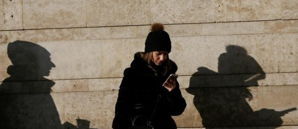 A woman uses her mobile phone in central Kiev, Ukraine December 13, 2016. REUTERS/Valentyn Ogirenko