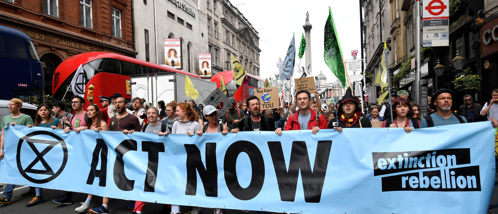 Demonstrators march along Whitehall during an Extinction Rebellion protest in London, Britain April 23, 2019. REUTERS/Toby Melville - RC1100C3C300